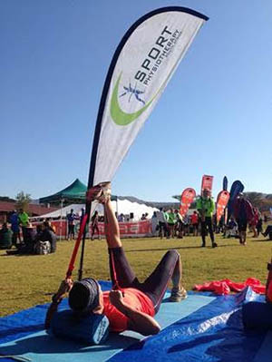 stretcging with Sports physio flag